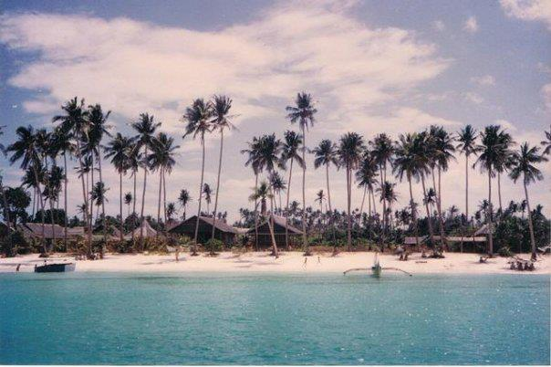 Tall trees and humble nipa huts on Old Boracay White Beach 1980s