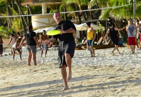 Beachgoer plays frisbee