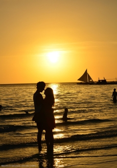 Lovers silhouette on sunset beach