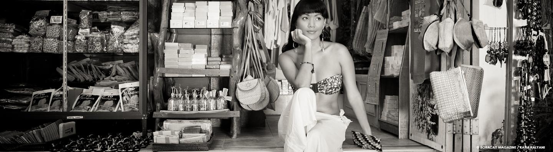 Female model in a small local souvenir shop