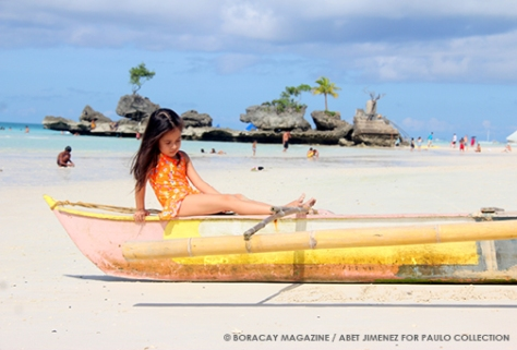 little girl on a boat by Willy's Rock Boracay beach
