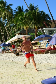 juggling coconuts while jogging on the beach