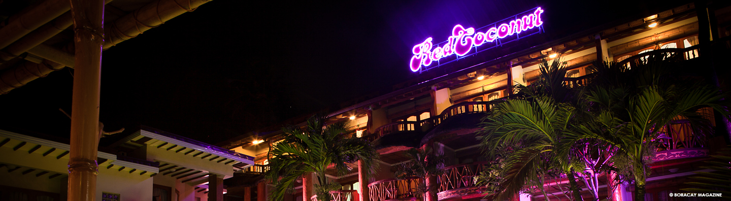 Red Coconut Boracay Beach Hotel facade at night