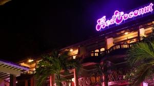 Red Coconut Boracay Beach Hotel facade at night