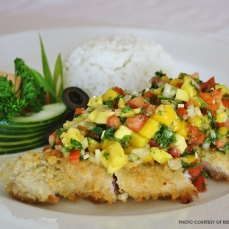 Breaded pork with mango salsa served with Mexican rice
