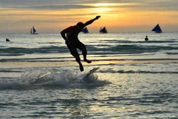 sunset skimboarding